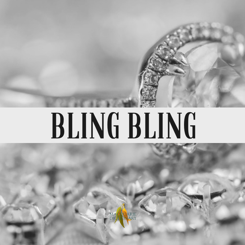 Macquarie Dictionary-bling bling-flashy, ostentatious, from blinger an extreme example of its kind; popularised by US rap singer BG in the song Bling Bling (1999).