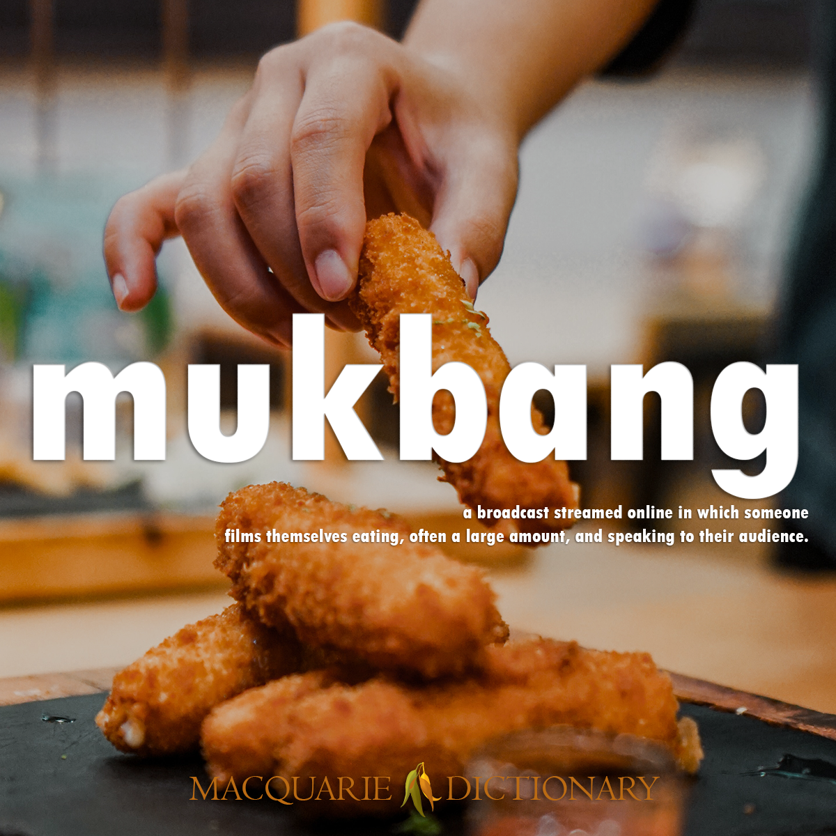 Image of Macquarie Dictionary Word of the Year mukbang a broadcast streamed online in which someone films themselves eating, often a large amount, and speaking to their audience.