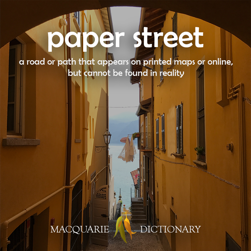 Image of definition of paper street: a road or path that appears on printed maps or online, but cannot be found in reality